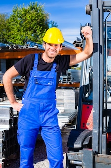 Builder with site pallet transporter or lift fork truck