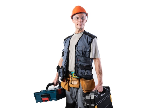 Builder with tools in cases. in a helmet and glasses, and unloading. for any purpose.