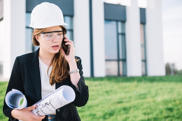 Builder woman talking on phone