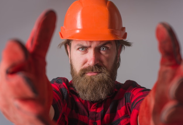 Builder work building industry technology workman in hardhat and work gloves advertise repairment