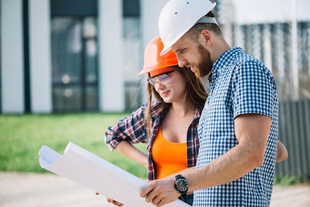 Builders reading blueprint
