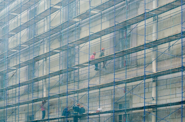 The builders on the scaffolding