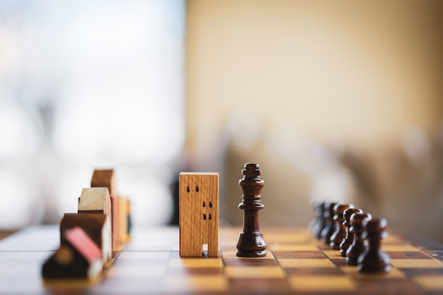 チェスゲームの建物と家のモデル、ビジネスの金融地区と商業