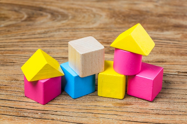 Building blocks on wooden background,colorful wooden building blocks