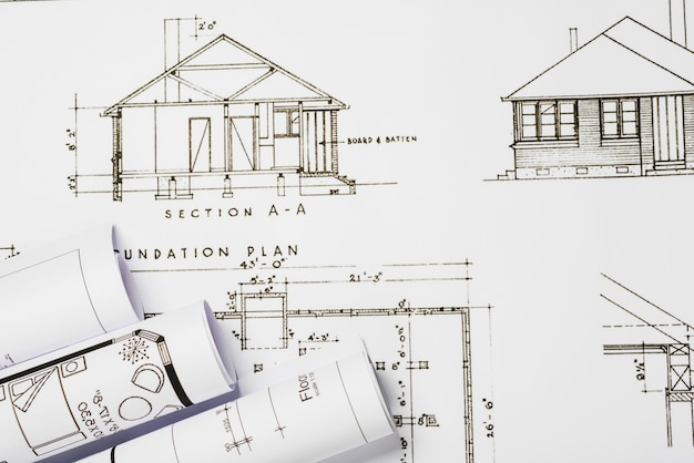 Building blueprints on table