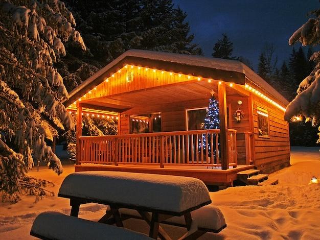 Building cabin snow winter illuminated enlighted