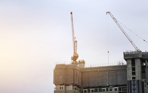 Building under construction site at evening sunlight.