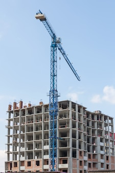 Building under construction and tower crane