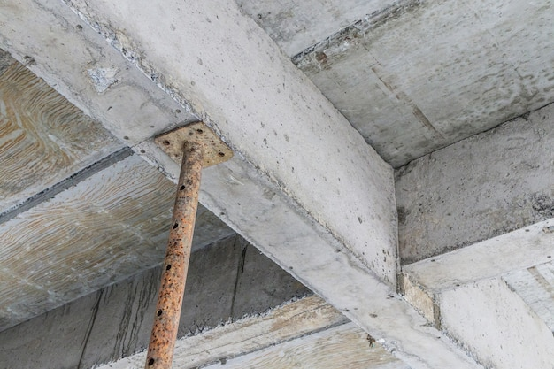 Building under construction with iron steel support concrete beams