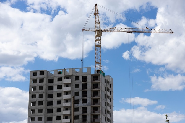Building under construction, workflow, construction projects, insulation and facade finishing.