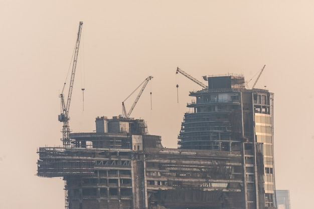 Building costruction of tall dubai marina skyscrapers in uae