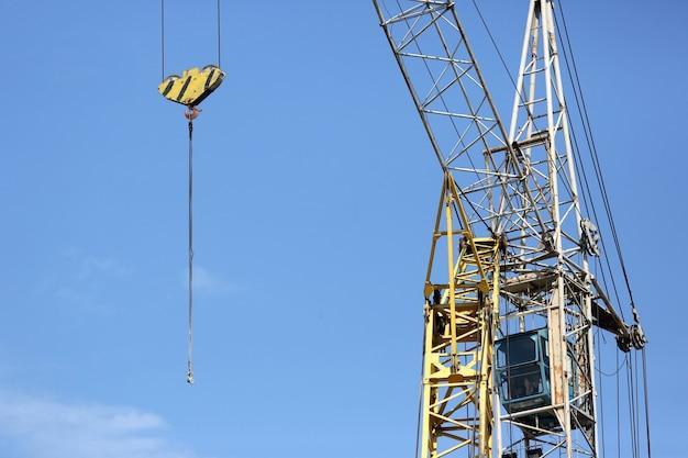 Building crane on blue sky