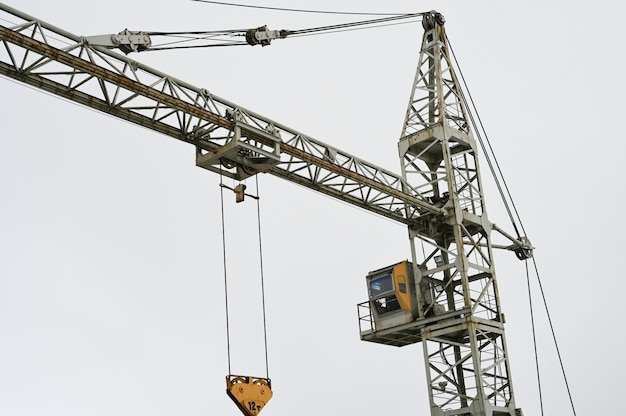 Building crane in cloudy weather