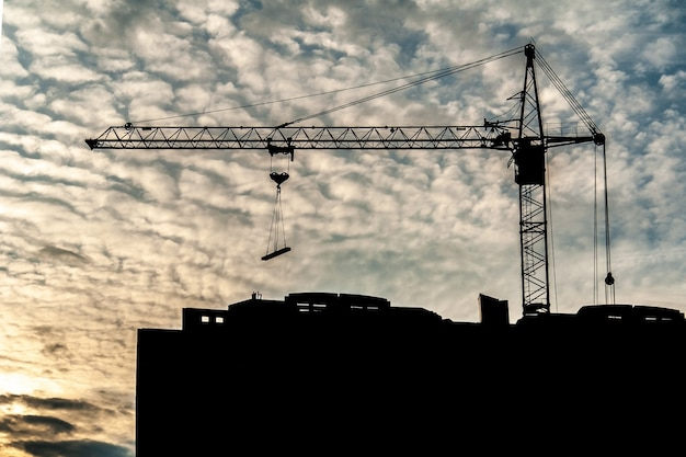Building crane working at sunset