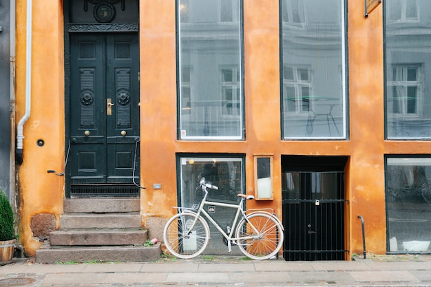 Building exterior with parked bicycle Free Photo