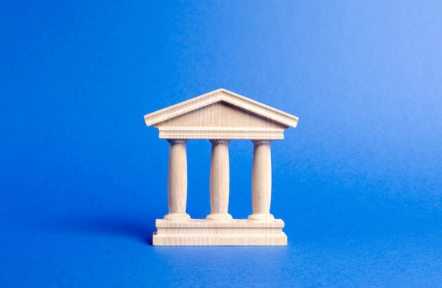 Building figurine with pillars in antique style concept of city administration bank university court or library