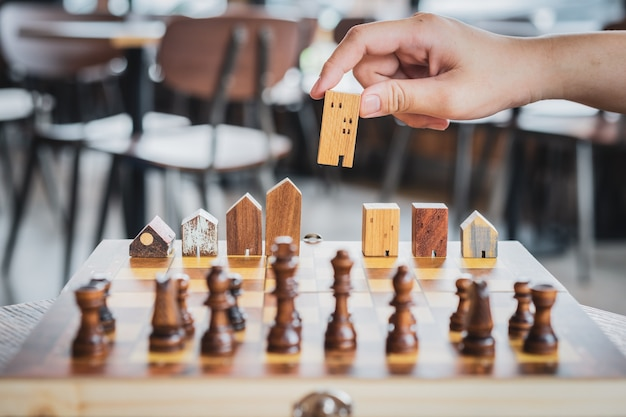 Building and house models in chess game, business financial district and commercial
