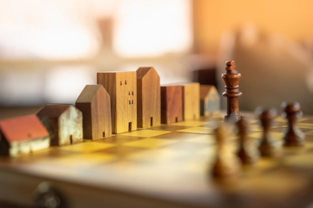 Building and house models in chess game, business financial