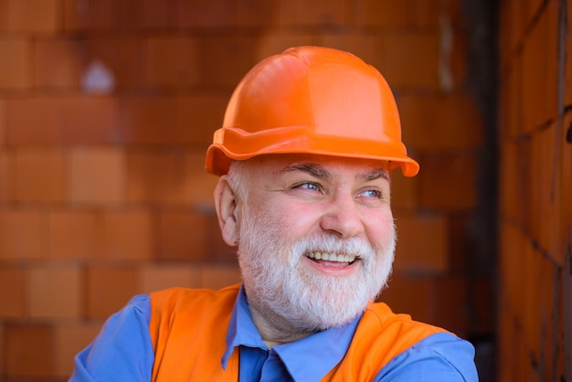 Building industry technology man in suit with construction helmet builder in hard hat engineers