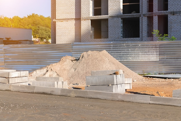 Building material on construction site territory. building a new houses with new quality material concept photo
