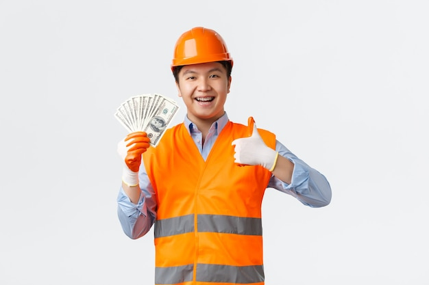 建築部門と産業労働者の概念。幸せ満足アジアビルダー、建設マネージャー