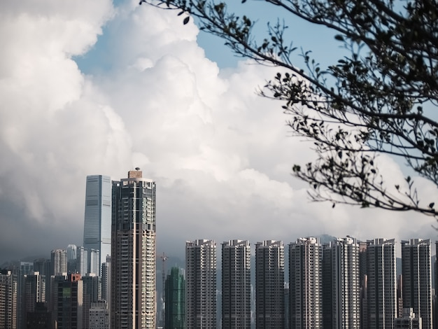 Building sky line background with white cloud in hong kong