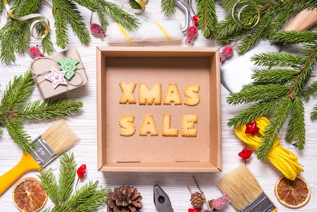 Building tools on wooden background, christmas sale concept
