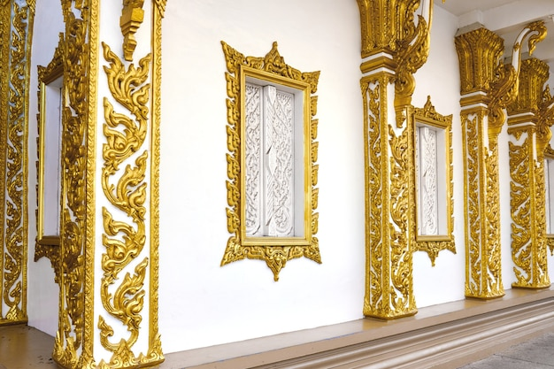 Building wall with windows decorated with oriental gold patterns