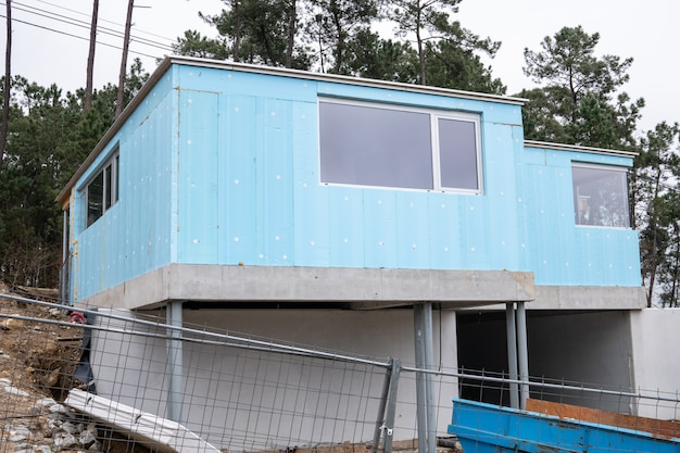 Building with blue rigid polystyrene panel