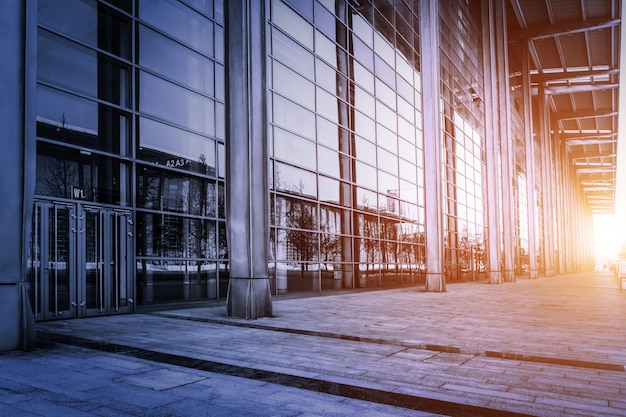 Building with glass walls at sunset
