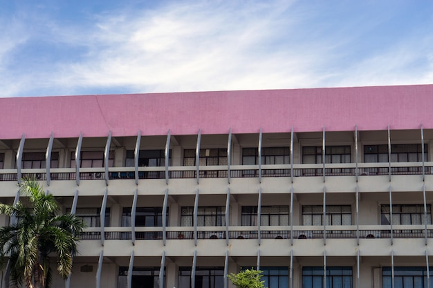 Buildings and architecture and pink roof with blue sky in thailand.