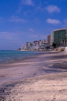 Buildings by the beach of salinas, ecuador
