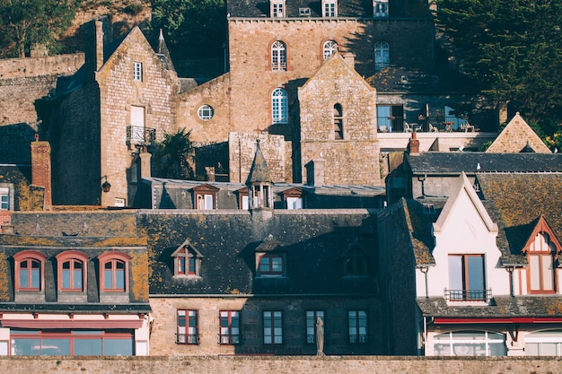 Buildings in le mont saint-michel tidal island in beautiful twilight at dusk, normandy, france