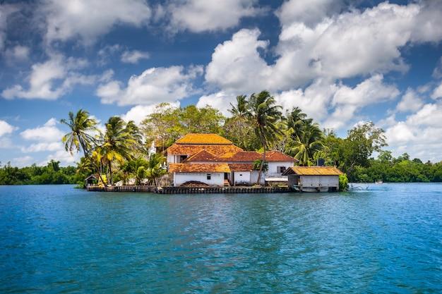 Buildings on peninsula, tropical plants. sri lanka