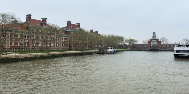 Buildings at the waterfront, ellis island, jersey city, new york state, usa