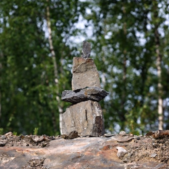 Built of stone inukshuk statue