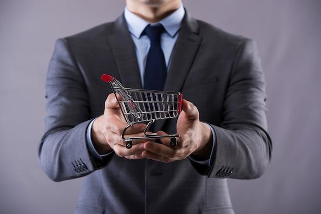 Buisinessman holding a shopping cart