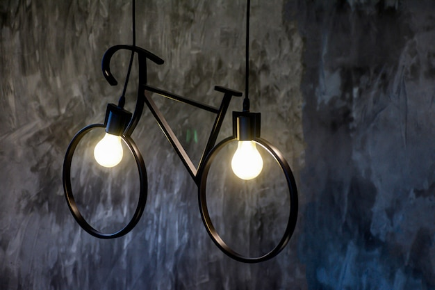 Bulb of light shape as bicycle for energy concept