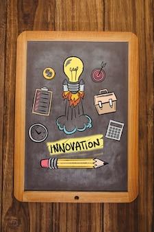 Bulb with rocket in a blackboard