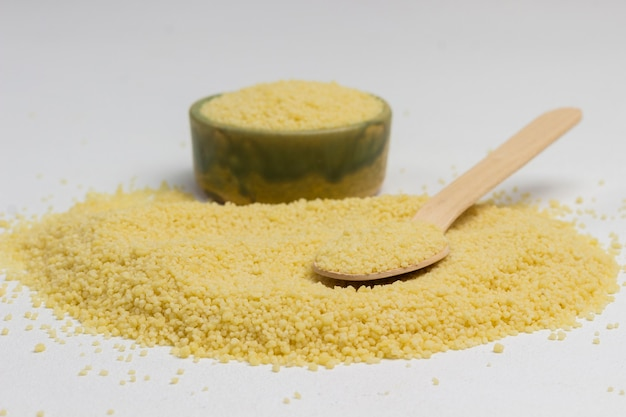 Bulgur source of natural protein, fiber and fat. bulgur scattered on white background.