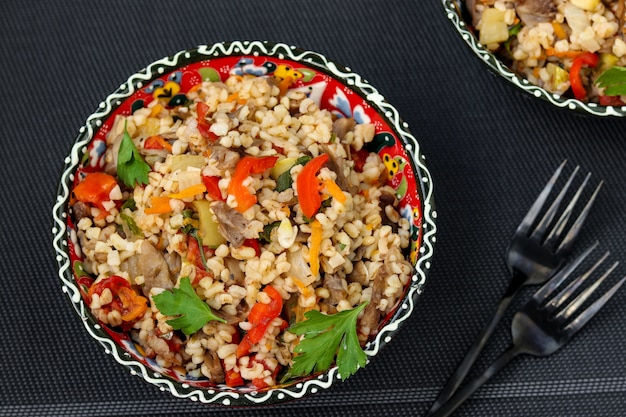 Bulgur with mushrooms and vegetables in a bowl