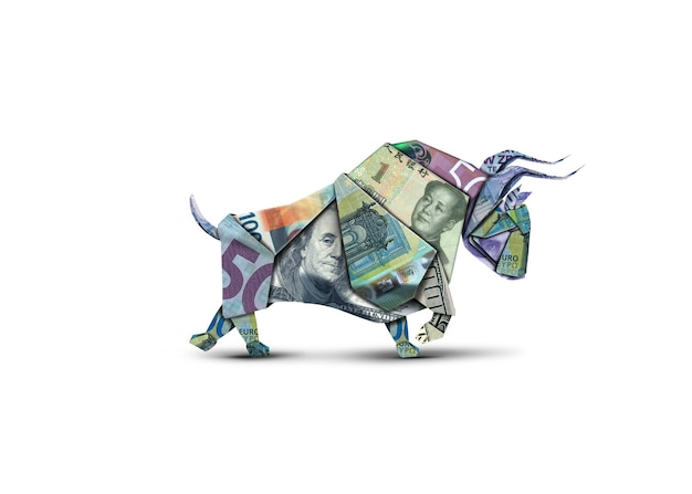 Bull shape made of banknotes on white isolated