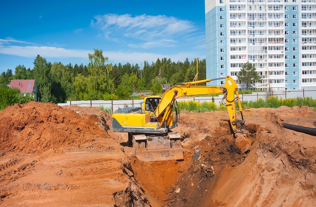 A bulldozer digs a trench on a construction site earthworks