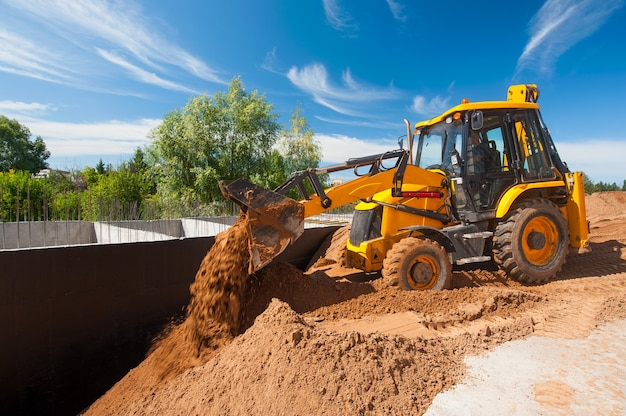 A bulldozer levels the ground at a construction site earthworks