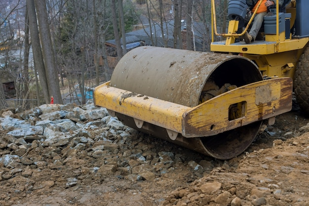 Bulldozer moves soil digging ground doing landscaping works