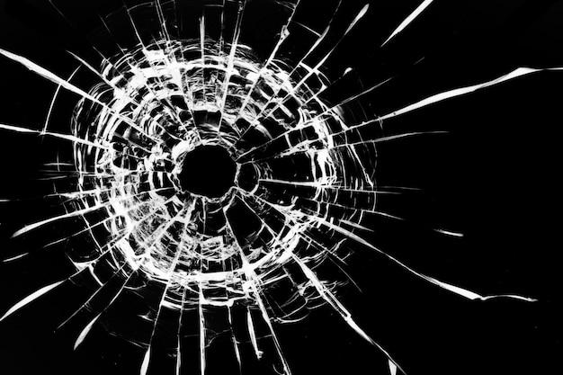 ガラスの銃弾の穴。黒の背景に分離。