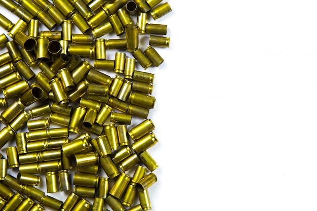 Bullets and shells pistol handgun background on white background