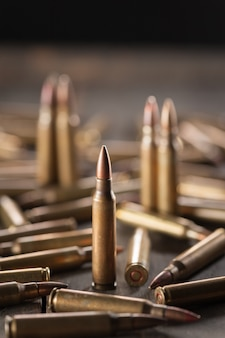 Bullets on wood table