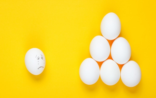 Bullying concept with eggs. top view, minimalism