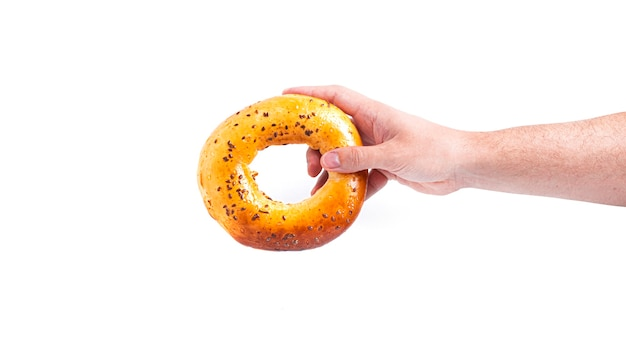 Bun bagel in hand isolated on a white backgroun. high quality photo